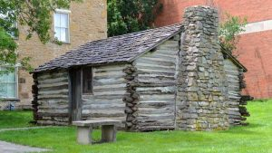 Replica Kibbee Cabin at the Old Castle Museum. It was here that leaders met and decided to form a college in the town of Palmyra, which is now Baldwin City. While Kibbee Cabin is a replica. Photo courtesy Old Castle Museum.