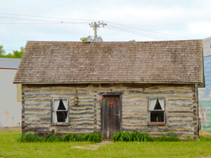 A historic cabin still stands in Blue Rapids, Kansas today by Kathy Weiser-Alexander.
