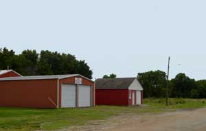 Voluntary Fire Department and small commercial building in Dunlap, Kansas by Kathy Weiser-Alexander.