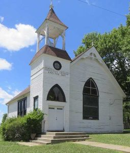 The 1897 Christian Church in Farmington, Kansas still stands today. Photo courtesy Courthouse Lover/Flckr