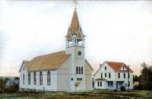 Annunciation Catholic Church and parish house in Frankfort, Kansas.