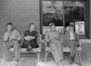 Men talking politics in Oskaloosa, Kansas by John Vachon, 1938.