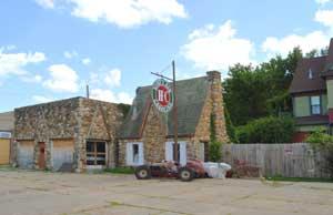 Old Sinclair Station in Emporia, Kansas by Kathy Weiser-Alexander.