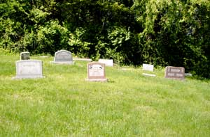 Monroe family graves at the Old Quindaro African-American Cemetery by Kathy Weiser-Alexander.