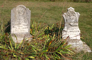 Grave stones at the old town of Diamond Springs, Kansas by Kathy Weiser-Alexander.