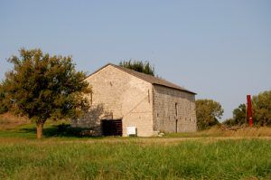 """This limestone barn was built by Seth Hays for his livestock. It was later used as a """"Poor House."""" Today, it is listed on the National Register of Historic Places. by Kathy Weiser-Alexander."""