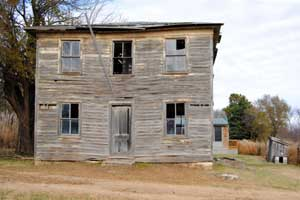 Abandoned building in Skiddy, Kansas by Kathy Weiser-Alexander.