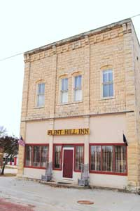 The old Jenkins Brothers Store still stands in White City and is now the Flint Hill Inn by Kathy Weiser-Alexander.