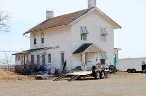 An old homestead appears to be utilized for construction  purposes, Kathy Weiser-Alexander.
