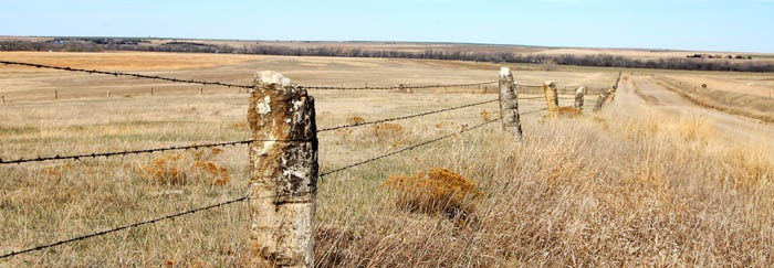 Schoenchen, Kansas area with post rock fence by Kathy Weiser-Alexander.