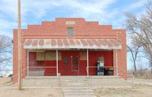 Old business building in Schoenchen, Kansas by Kathy Weiser-Alexander.