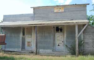 Old business building in Lamont, Kansas by Kathy Weiser-Alexander.