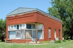 An abandoned business building in Neal, Kansas by Kathy Weiser-Alexander.