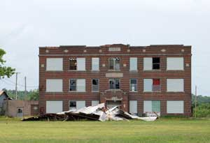 Old highschool in Piedmont, Kansas by Kathy Weiser-Alexander.