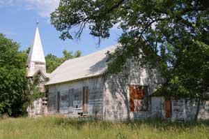 An abandoned church still stands in Quincy, Kansas by Kathy Weiser-Alexander.