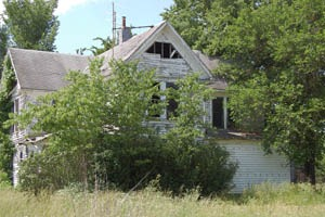 This large home in Quincy, Kansas will soon be taken over by the elements by Kathy Weiser-Alexander.