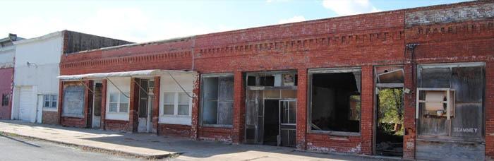 Old commercial buildings in Elk City, Kansas by Kathy Weiser-Alexander.