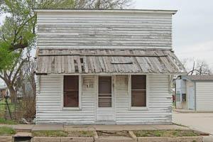 Old business building in Burdett, Kansas by Kathy Weiser-Alexander.