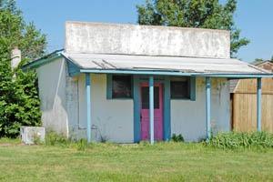 Old business building in Mantey, Kansas by Kathy Weiser-Alexander.