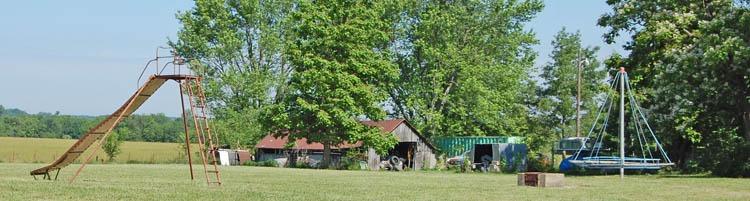Play equipment next to the old Mantey, Kansas School by Kathy Weiser-Alexander.