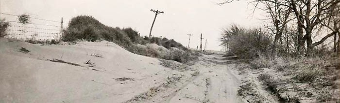 A dusty road in Ford County, Kansas in the 1930s.