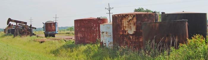 Old oil field tanks near Hailton, Kansas by Kathy Weiser-Alexander.