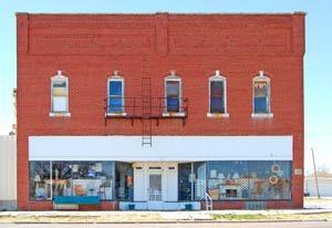 Old grocery store in McCracken, Kansas by Kathy Weiser-Alexander.