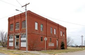 Old business building in Otis, Kansas by Kathy Weiser-Alexander.