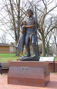 Statue of Shawnee Indian Leader, Paschal Fish, and his daughter, Eudora, for whom the town is named.