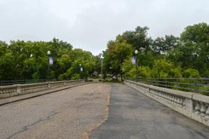 Cottonwood River Bridge in Cottonwood Falls, Kansas by Kathy Weiser-Alexander.