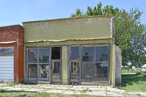 An old business building in Clayton, Kansas by Kathy Weiser-Alexander.