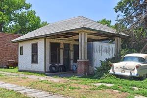 Old gas station in Clayton, Kansas by Kathy Weiser-Alexander.