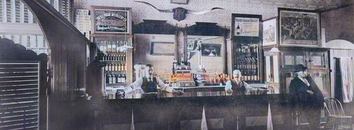 Bill Bader & Louis Laubner saloon in Dodge City, about 1895.